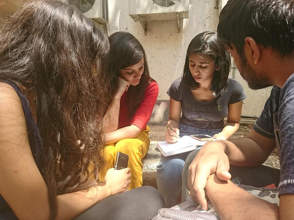 Students from National Institute of Fashion Technology, Bangalore sketching out a design with the models as part of a workshop, asked to make customised designs after consulting with real people, organised by me during my stint as Assistant Professor (ADHOC) in the same university